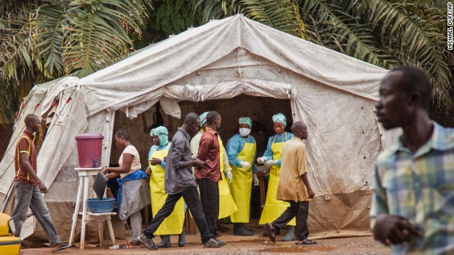 Health workers in Kenema screen people for the Ebola virus on Saturday, August 9, before they enter the Kenema Government Hospital.