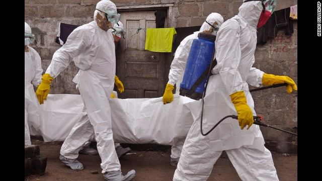 Health workers on Wednesday, September 10, carry the body of a woman who they suspect died from the Ebola virus in Monrovia.