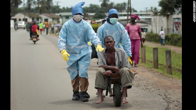 Residents of the St. Paul Bridge neighborhood in Monrovia take a man suspected of having Ebola to a clinic on September 28.