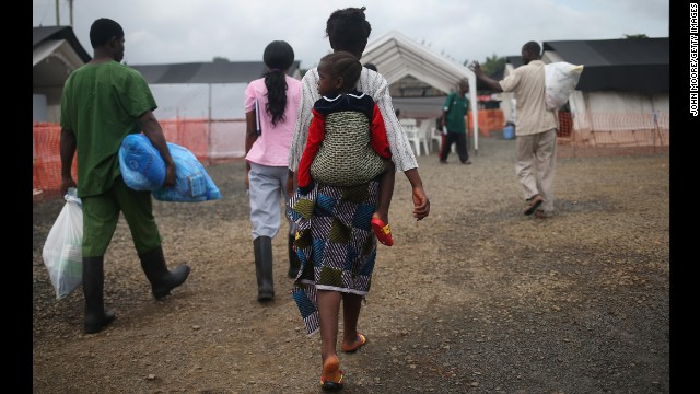 Ebola survivors prepare to leave a Doctors Without Borders treatment center after recovering from the virus in Paynesville, Liberia, on October 12.