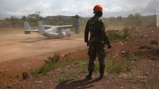 A member of the Liberian army stands near a U.S. aircraft Saturday, October 11, in Tubmanburg.