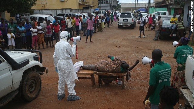 Aid workers from the Liberian Medical Renaissance League stage an Ebola awareness event October 15 in Monrovia. The group performs street dramas throughout Monrovia to educate the public on Ebola symptoms and how to handle people who are infected with the virus.