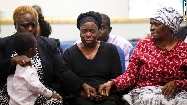 Garteh Korkoryah, center, is comforted during a memorial service for her son, Thomas Eric Duncan, on Saturday, October 18, in Salisbury, North Carolina. Duncan, a 42-year-old Liberian citizen, died October 8 in a Dallas hospital. He was in the country to visit his son and his son's mother, and he was the first person in the United States to be diagnosed with Ebola.