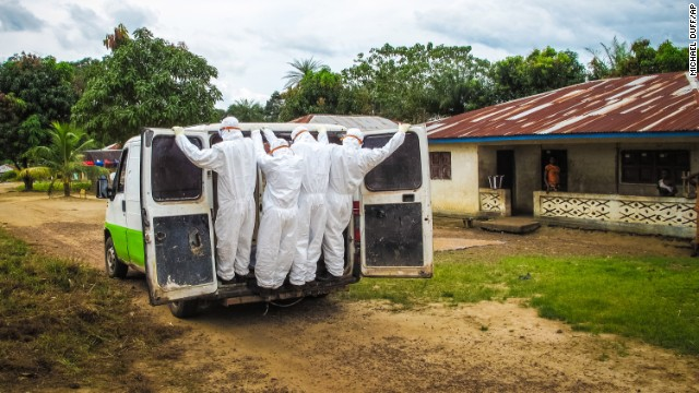 Health workers in Port Loko, Sierra Leone, transport the body of a person who is suspected to have died of Ebola on Tuesday, October 21.