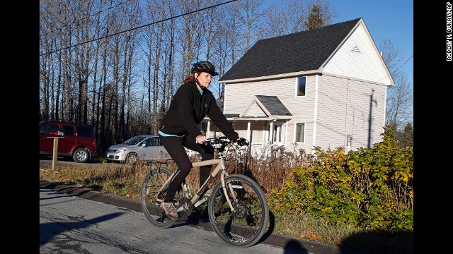 Kaci Hickox leaves her home in Fort Kent, Maine, to take a bike ride with her boyfriend on Thursday, October 30. Hickox, a nurse, recently returned to the United States from West Africa, where she treated Ebola victims. State authorities want her to avoid public places for 21 days -- the virus' incubation period. But Hickox, who has twice tested negative for Ebola, has said she will defy efforts to keep her quarantined at home.