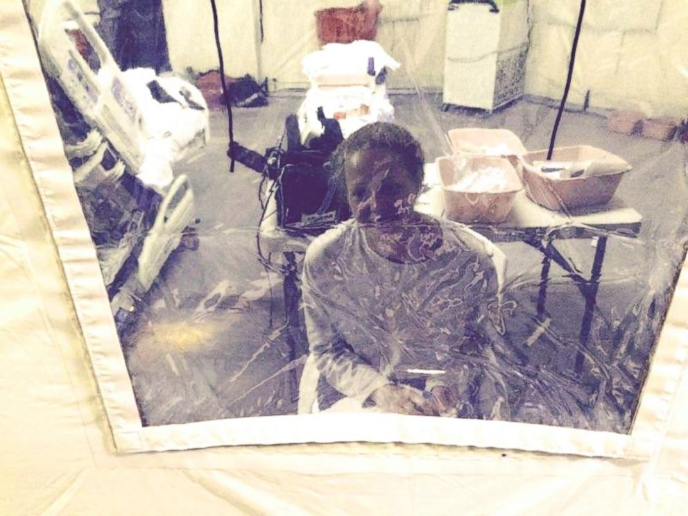 Kaci Hickox is seen sitting inside the isolation tent she has been housed in at University Hospital in Newark, New Jersey.