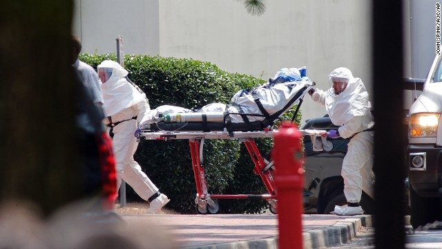 Aid worker Nancy Writebol, wearing a protective suit, gets wheeled on a gurney into Emory University Hospital in Atlanta on August 5. A medical plane flew Writebol from Liberia to the United States after she and her colleague Dr. Kent Brantly were infected with the Ebola virus in the West African country.
