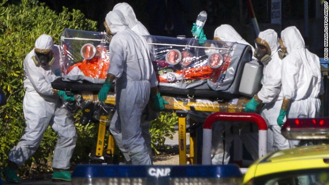 Paramedics in protective suits move Pajares, the infected Spanish priest, at Carlos III Hospital in Madrid on Thursday, August 7. He died five days later.