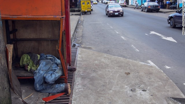 A body, reportedly a victim of Ebola, lies on a street corner in Monrovia on Saturday, August 16.