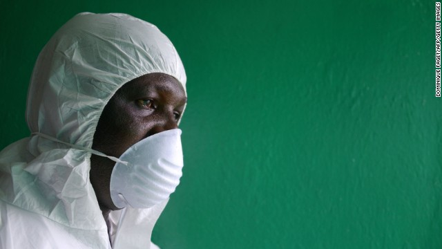 A health worker wearing a protective suit conducts an Ebola prevention drill at the port in Monrovia on Friday, August 29.