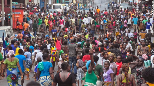 Crowds cheer and celebrate in the streets Saturday, August 30, after Liberian authorities reopened the West Point slum in Monrovia. The military had been enforcing a quarantine on West Point, fearing a spread of the Ebola virus.
