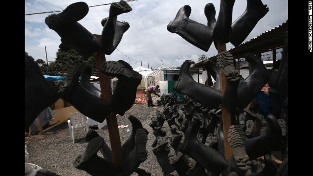Sanitized boots dry at the Doctors Without Borders treatment center in Paynesville on October 5.