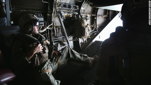 A U.S. Marine looks out from an MV-22 Osprey aircraft before landing at the site of an Ebola treatment center under construction in Tubmanburg on October 15. It is the first of 17 Ebola treatment centers to be built by Liberian army soldiers and American troops as part of the U.S. response to the epidemic.