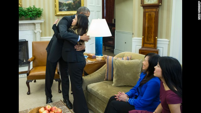 U.S. President Barack Obama hugs Ebola survivor Nina Pham in the Oval Office of the White House on Friday, October 24. Pham, one of the two Dallas nurses who were diagnosed with the virus, was declared Ebola-free after being treated at a hospital in Bethesda, Maryland.