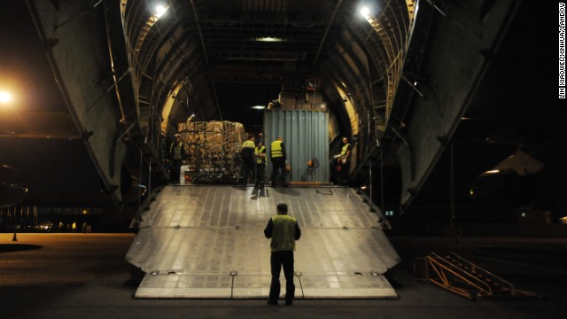 Crew members at an airport in Accra, Ghana, unload supplies sent from China on Wednesday, October 29.