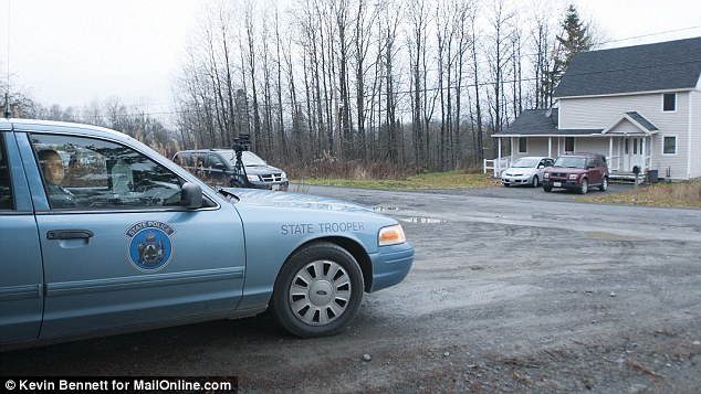 State police troopers were stationed outside the Fort Kent, Maine, home of Kaci Hickox on Wednesday after she threatened to break Maine quarantine guidelines - however they are voluntary at the moment so it is unclear whether they would have the authority to arrest her without a court order