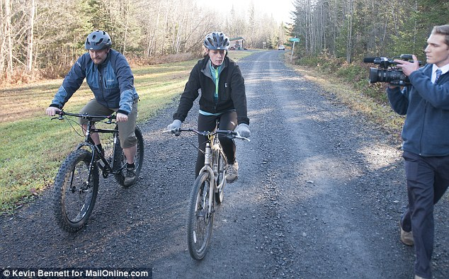 The 33-year-old nurse went on a bike ride with her partner Ted Wilbur this morning as she defied the mandatory Ebola quarantine placed on her by the state of Maine