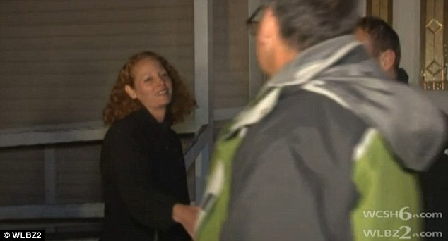 MailOnline reporter Martin Gould (pictured right) shakes the hand of nurse Kaci Hickox (left) outside her home in Fort Kent, Maine on Wednesday after she stepped outside to defy the state's Ebola quarantine