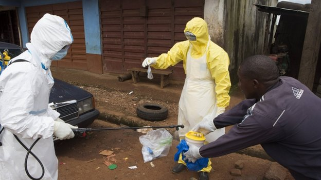 Health workers in protective equipment near Rokupa Hospital, Freetown on 6 October 2014.